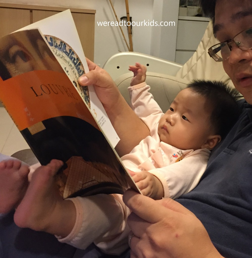 Father reading to a toddler